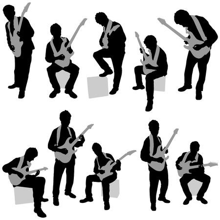 man playing electrical guitar set