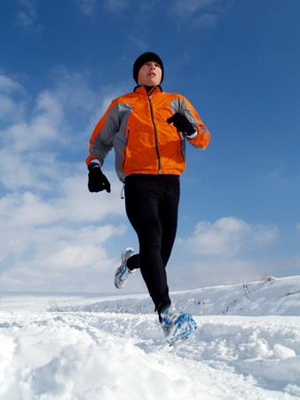 men running: Runner in Snow
