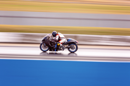 A racing motorcycle competitor at a drag way meet to keep speed off the streets