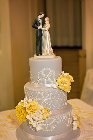 A grey and white themed wedding cake with yellow flowers and stock a grey and white themed wedding cake with yellow flowers and wedding topper stock photo mightylinksfo