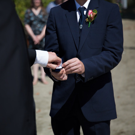 Two men exchanging rings during their wedding ceremony