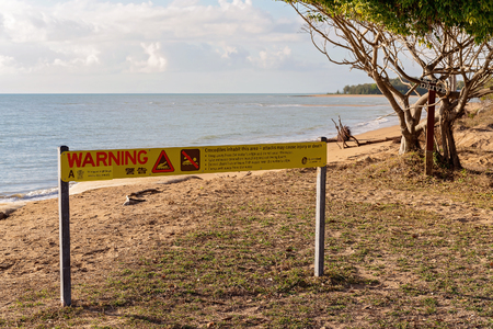 A crocodile warning sign on a beach in north Queensland Australia
