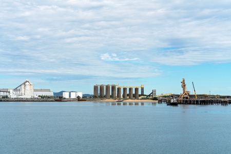 Infrastructure of an Australian citys harbor wharf exporting sugar and grain