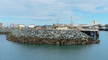 Breakwater of Australian harbor with infrastructure for export of mining and agriculture commodities