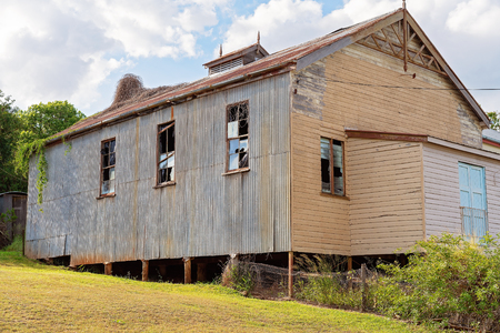 Old small town closed country hall falling into disrepair, probably used for community and dances Stock Photo