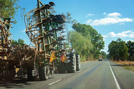 Haulage of large agricultural equipment by road on a highway in Australia Stock Photo