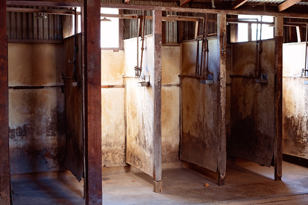 Neglected and unhygienic shower stalls used by gold miners during the Victorian gold rush days in Australia
