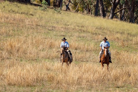 CORRYONG, VICTORIA, AUSTRALIA - APRIL 5TH 2019: The Man From Snowy River Bush Festival re-enactment, riders on horseback come down from out of the bush on 5th April 2019 during the re-enactment of Banjo Pattersons epic poem.