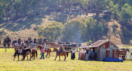 CORRYONG, VICTORIA, AUSTRALIA - APRIL 5TH 2019: The Man From Snowy River Bush Festival re-enactment, riders on horseback herd wild horses to homestead on 5th April 2019 during the re-enactment of Banjo Pattersons epic poem.
