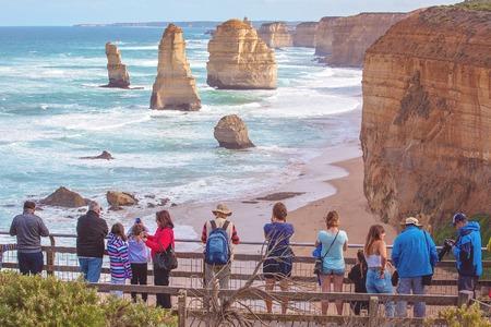 THE GREAT OCEAN ROAD, VICTORIA, AUSTRALIA - APRIL 18TH 2019: Spectators on the viewing platform at The Twelve Apostles, famous tourist destination
