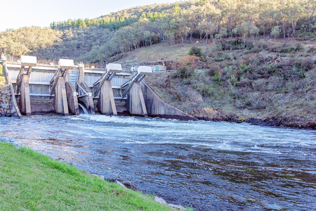 Dam conserving water on the upper reaches of the Murray River In Australia Фото со стока