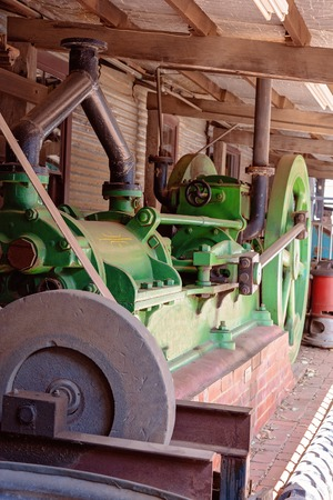 Vintage gold mining machinery now on display as a tourist attraction in an old abandoned gold mine in an Australian country town