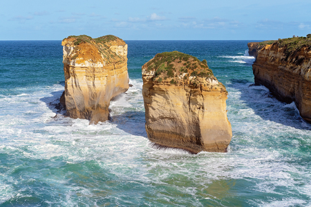 The unusual limestone rock formations on the well known coast of Australia - The Great Ocean Road Фото со стока