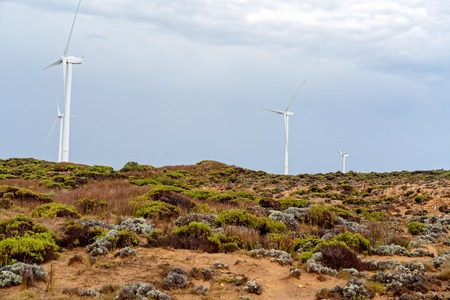 A wind turbine on the coast of Victoria Australia at Cape Bridgewater, an area known for its petrified forest and blow hole near Portland Banque d'images