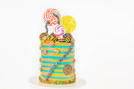 On-trend candyland fantasy cake for birthdays or any festive occasion, isolated against a white background