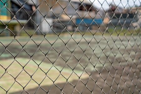 Chain link fence keeping people from entering a manufacturing business in an industrial area where public are prohibited
