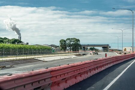 Construction of a highway in an Australian country town to bypass the city and facilitate an improved traffic flow Фото со стока
