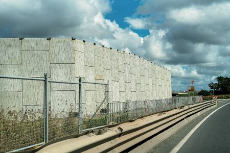 A brick wall as part of a highway construction to bypass an Australian country town and improve traffic flow Фото со стока