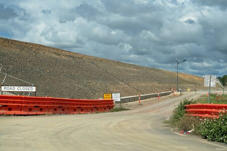 A built up road as part of a highway construction project in an Australian country town to improve traffic flow Stockfoto - 125244493