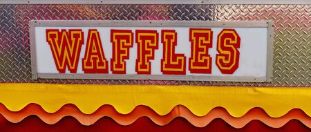 Bright and colorful waffles sign at an Australian country show