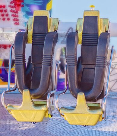 Close up of seats on a thrilling amusement park ride at a country show