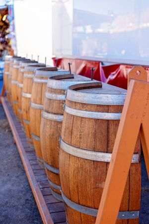 A row of wine barrel shapes forming a counter at a country fair Фото со стока