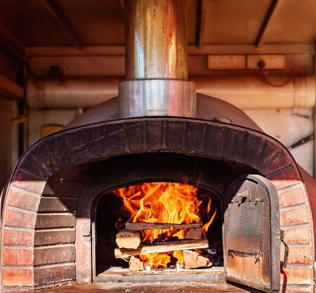 A wood fired pizza oven for cooking savory food for the public at events like festivals, carnivals and other entertainment attractions