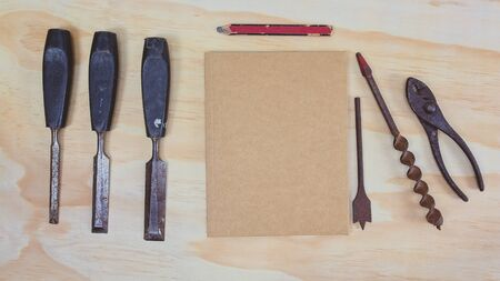 Old work tools with carpenter pencil and blank card for fathers day message on timber background top view flatlay with copy space