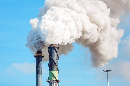 Clouds of smoke emitted into the environment from crushing season at an Australian sugar cane mill refinery