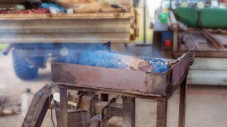 A hot and glowing blacksmith forge for heating and shaping objects by hand