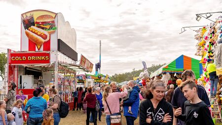 SARINA, QUEENSLAND, AUSTRALIA - AUGUST 2019: Crowd on sideshow alley enjoying local country show