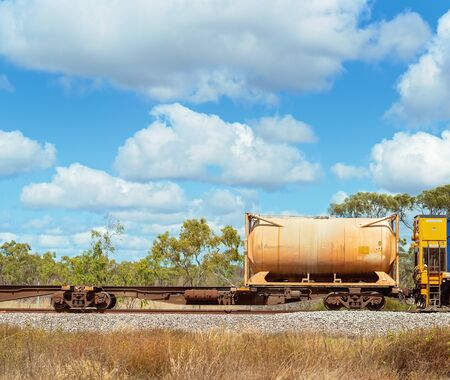 Tanker being transported by train through the Australian countryside Фото со стока - 129924983