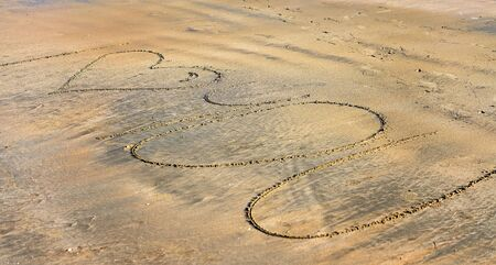 I heart you love message written on a sandy beach Imagens