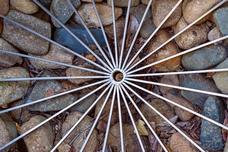 Spiral shaped steel wire enclosing stones to make a retaining wall Stok Fotoğraf