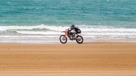 Mackay, Queensland, Australia - September 8th 2019: Motorcycle beach racing by the ocean