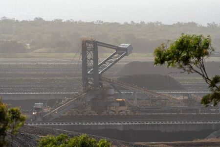 A coal ship loader at an Australian export terminal on a hazy day polluted by intense bush fire smoke