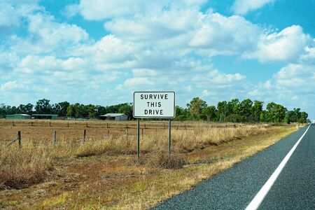 Survive this drive roadside sign on an Australian country highway