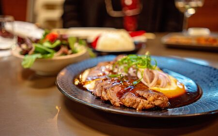 A wagu steak dish with potato mash served in a Japanese restaurant Stok Fotoğraf
