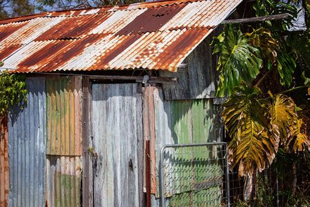 A dilapidated rusted old iron shed no longer in use