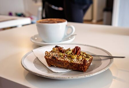 A fig and seed gluten free slice and a cappuccino for morning tea