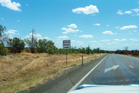 Merge right arrow sign on an Australian country highway