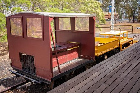 A vintage railway carriage on display at a tourist highway rest stop and small village Australia Фото со стока
