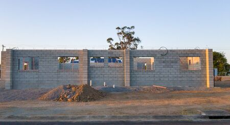 A concrete block home being built in an urban subdivision in a country town Фото со стока