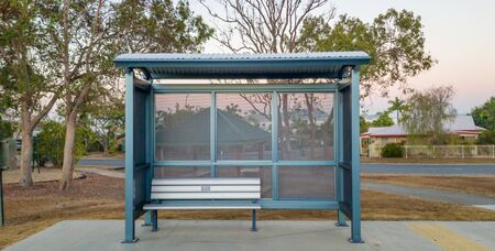 A bus stop shelter in front of a barbecue area in an Australian country town