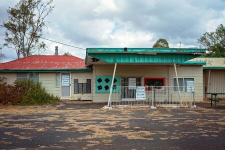 Roma, Queensland, Australia - October 2019: An auto centre closed down abandoned and now for lease