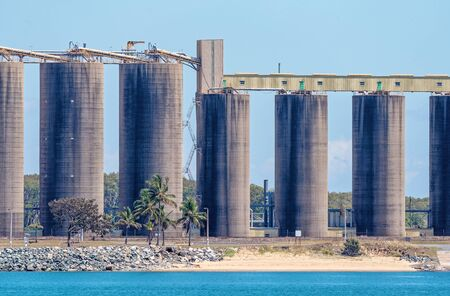 Storage silos at an Australian harbour wharf where sugar and grain are exported around the world