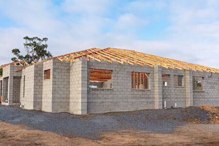 A suburban home under construction in a new town subdivision