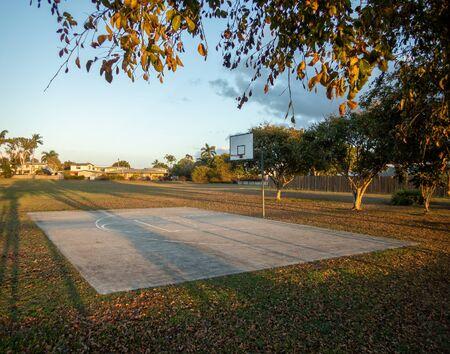 An outdoor public basketball practice court in a suburban street