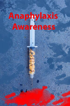 A conceptual image of nuts in a syringe, awareness brochure eating peanuts can cause a severe allergic reaction, illustrated background with calligraphy Banco de Imagens