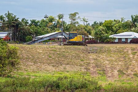 Mackay, Queensland, Australia: 3rd November 2019: Machinery lying idle on the weekend during work in a residential subdivision next to the Botanic Gardens